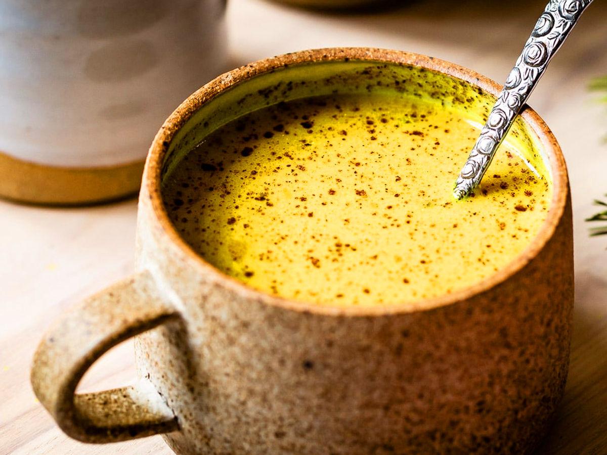 golden milk tea served in a cup