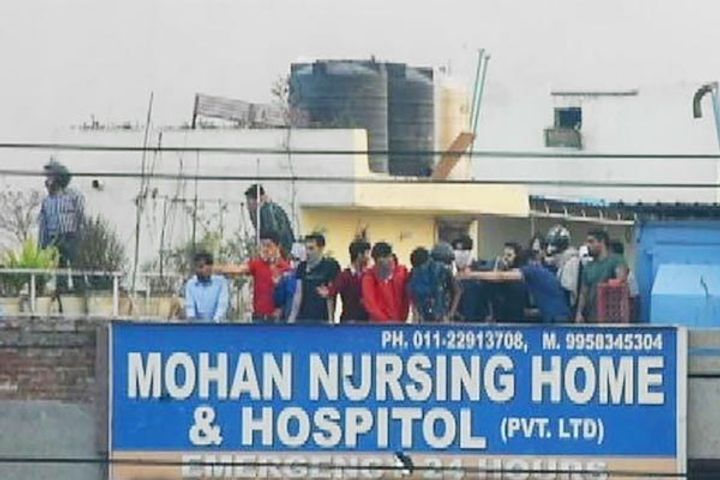 New video shows men firing on crowd from hospital roof during Delhi riots