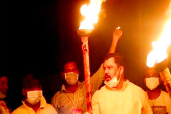 BJP MLA lights torch chants slogan against Covid-19 with supporters in Hyderabad