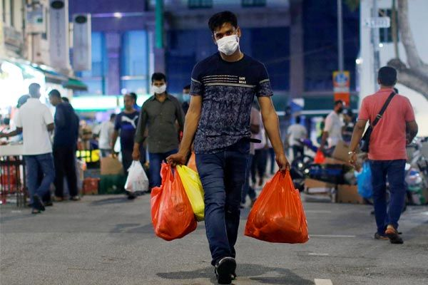 Singapore quarantines 20,000 migrant workers after COVID-19 cases rise