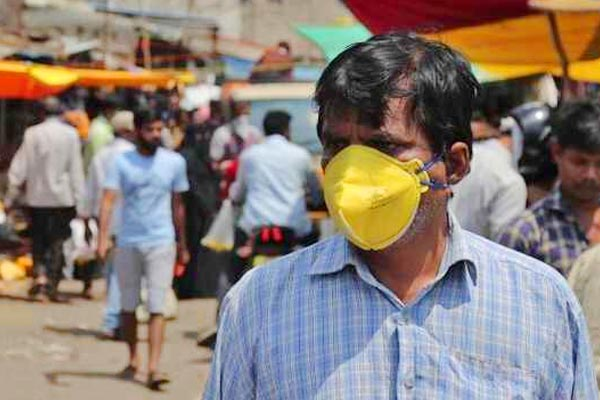 Coronavirus can survive on face masks for a week