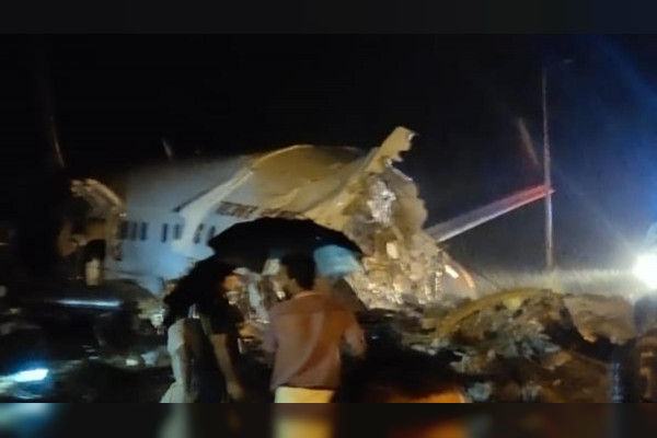 Air India plane crashes while landing breaks in two at Karipur Airport in Kozhikode 3 people includi