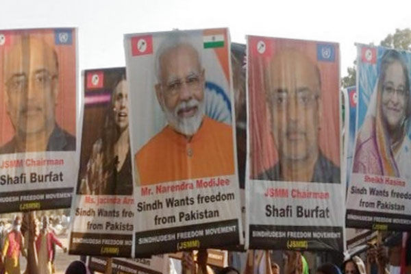 Modi posters raised at pro freedom rally in Sindh