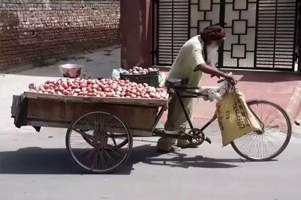100-year-old man pulls cart