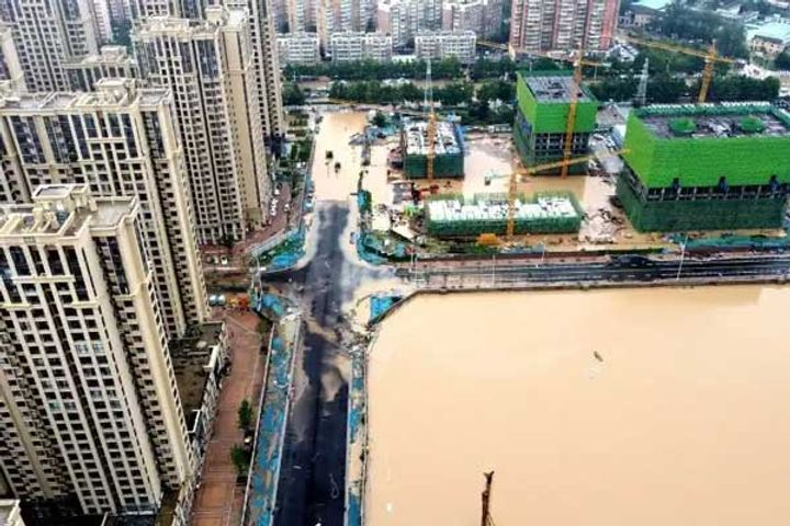 Chinese soldiers blast dam to divert floodwaters as record rains kill 25