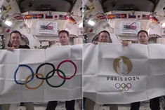 Astronauts take Tokyo Olympics to space