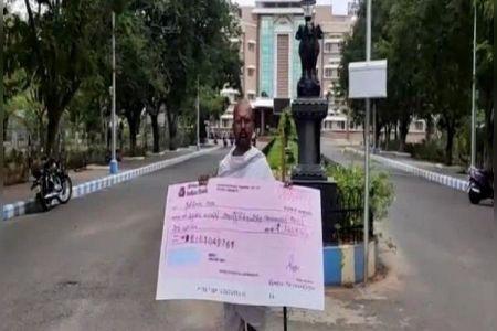 A man in Gandhi dress arrived to help the debt ridden Tamil Nadu government