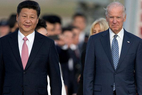 Joe Biden talks to Xi Jinping